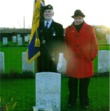 Katrina Bradley with RBL Colours at William Barker's grave