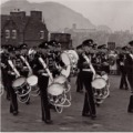 1958: Band & Drums of the 4/6th Btn, The Royal Lincolnshire Regt and the Band & Drums of the TA, The Sherwood Forresters, beating retreat at Edinburgh Castle.