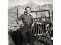 Fred Wragg (Royal Lincolnshire Regiment) - Middle East, 1947-50 (2) Leaning on a rather battered Willys MB 'Jeep' with painted Middle East Land Forces (M.E.L.F.) GHQ formation sign (camel) & bridge plate (2 ton) markings. The meaning of the 'ALO' lettering on the windscreen frame is unknown to me, but it's been suggested that it might possibly stand for either 'Air Liaison Officer' or 'Artillery Liaison Officer'...