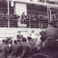Boxing match. The audience are waiting for knock out in the boxing match. The fighters are some of the younger passengers. Empress of Australia October 1946.