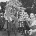 Dragon Dance. Kuala Lumpur.  The yearly Chinese dragon dance performed in the street.  Dated 15 March 1947.
