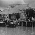 Port Weld. Typical houses at a river bank near Port Weld. January 1947.
