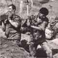 Pte Leadbetter (machine gunner), L/Cpl 'Dusty' Hocking and Pte Van der Walt - digging.  Starvation exercise, Brecon, 1983.