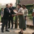 Derek Hocking presenting a shield to Arkela (Arnhem Scouts).  The shields were made by Ralph Chapman.