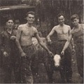 Pts Smith, Lewis, Evans and Dunning with a stray cow. Jan 1946, Padang.