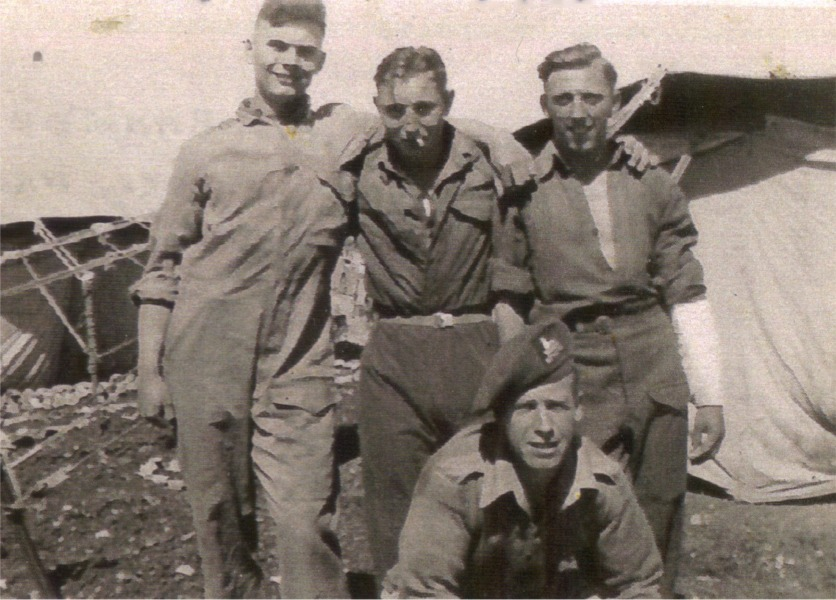 Mount Scopius, Jerusalem. Ernest 'Spud' Taylor with Bampton (bandaged arm) & two other mates.