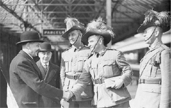 Gunner A.P. Sullivan V.C. bringing home the ashes of Sergt. Arthur Evans, is greeted by Mr. W. Ratcliffe of the British Legion