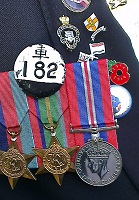 Medals and Prisoner pf War badge (Japanese) belonging to Mick Ream's late father, 11th November 2014.